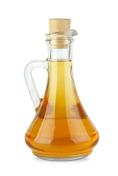 Decanter with apple vinegar stock photo