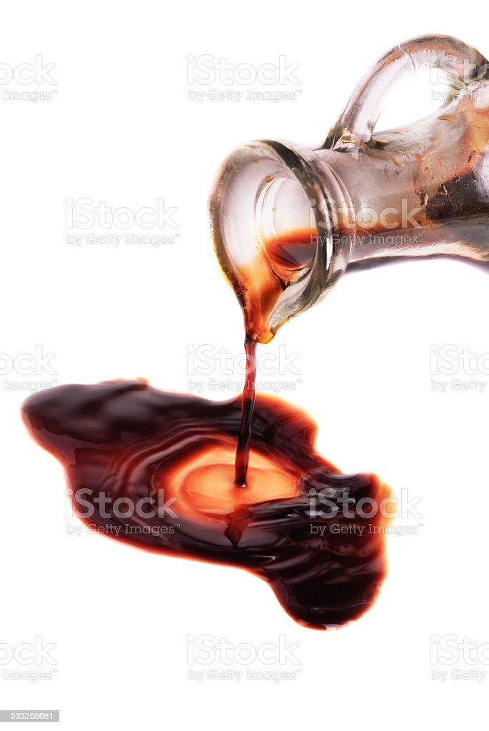 decanter with balsamic vinegar isolated on the white background stock photo