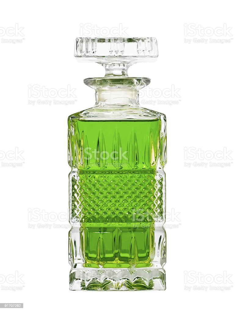 Decanter with green fluid stock photo