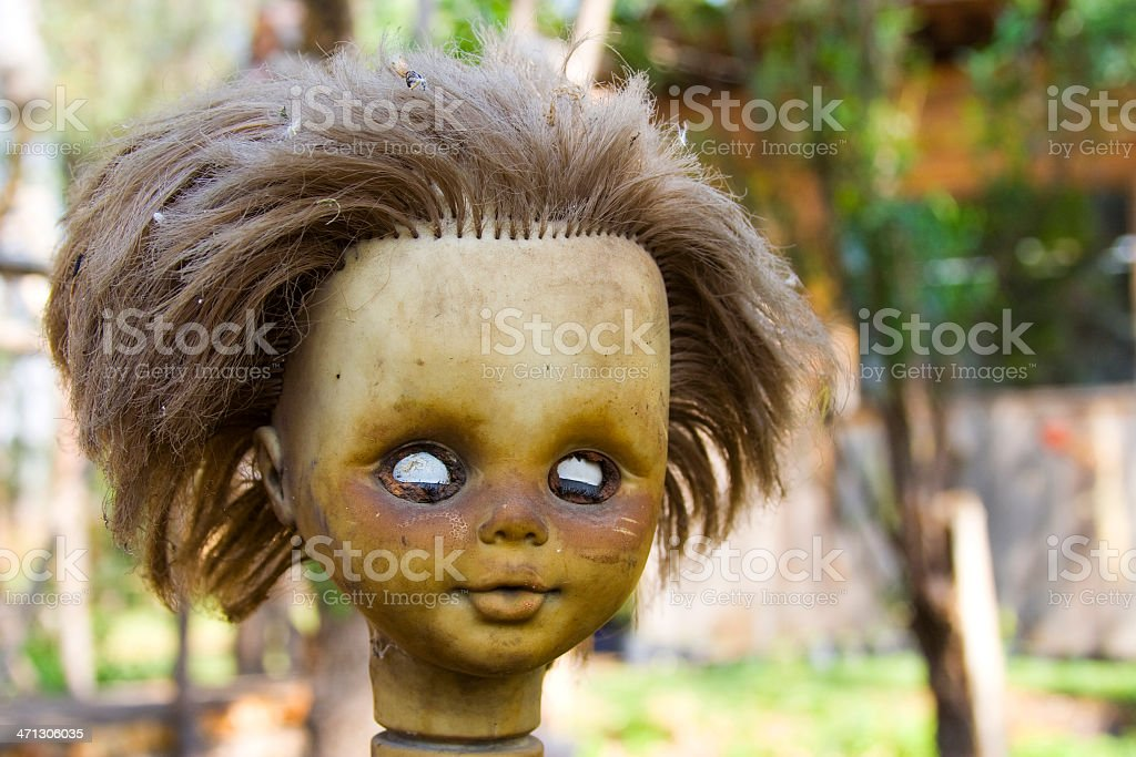 Decapitated doll stock photo