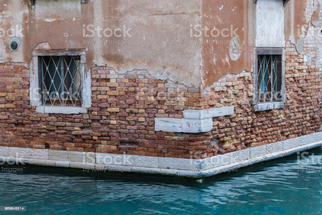 Decayed building wall in Venice, Italy stock photo