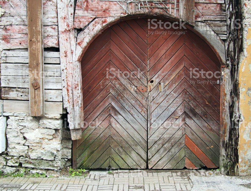 Decayed wooden double doors. stock photo