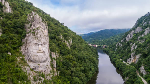 decebal head sculpted in rock - romania stock photos and pictures