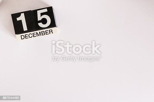 istock December 15th. Day 15 of month, calendar on white background. Winter concept. Empty space for text 887544492