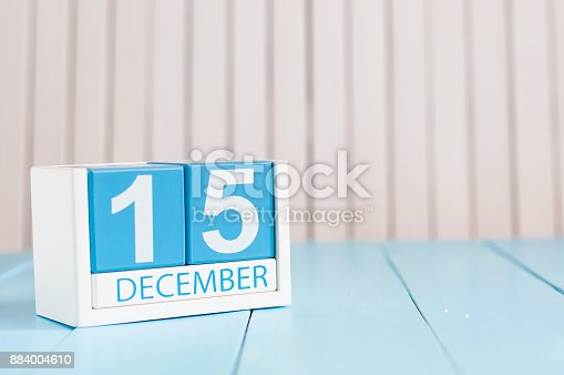 istock December 15th. Day 15 of month, calendar on wooden background. Winter concept. Empty space for text 884004610