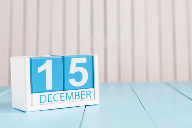 December 15th. Day 15 of month, calendar on wooden background. Winter concept. Empty space for text stock photo