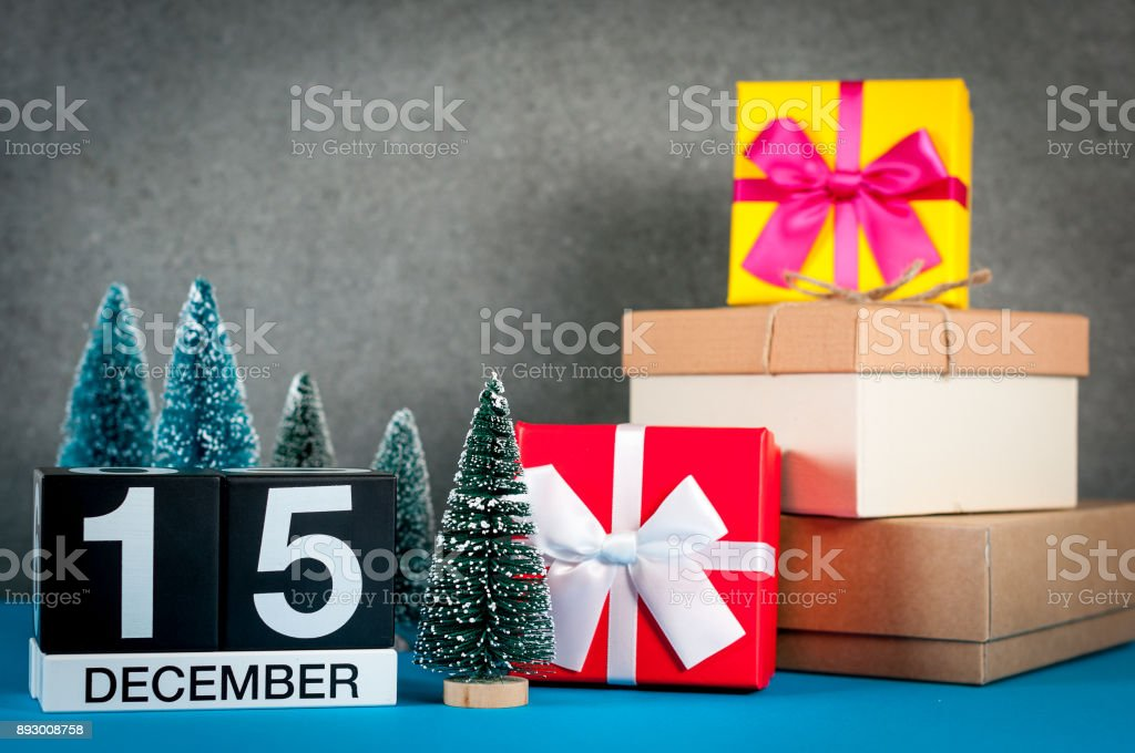 December 15th. Image 15 day of december month, calendar at christmas and new year background with gifts and little Christmas tree stock photo