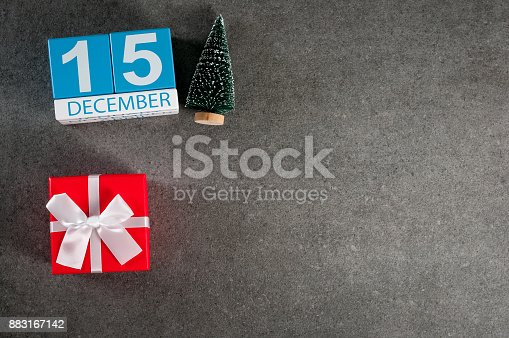istock December 15th. Image 15 day of december month, calendar with x-mas gift and christmas tree. New year background with empty space for text, mockup 883167142