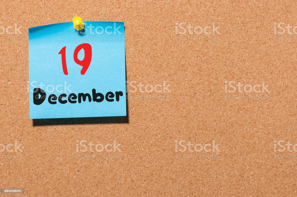 December 19th. Day 19 of month, Calendar on cork notice board. Winter time. Empty space for text stock photo