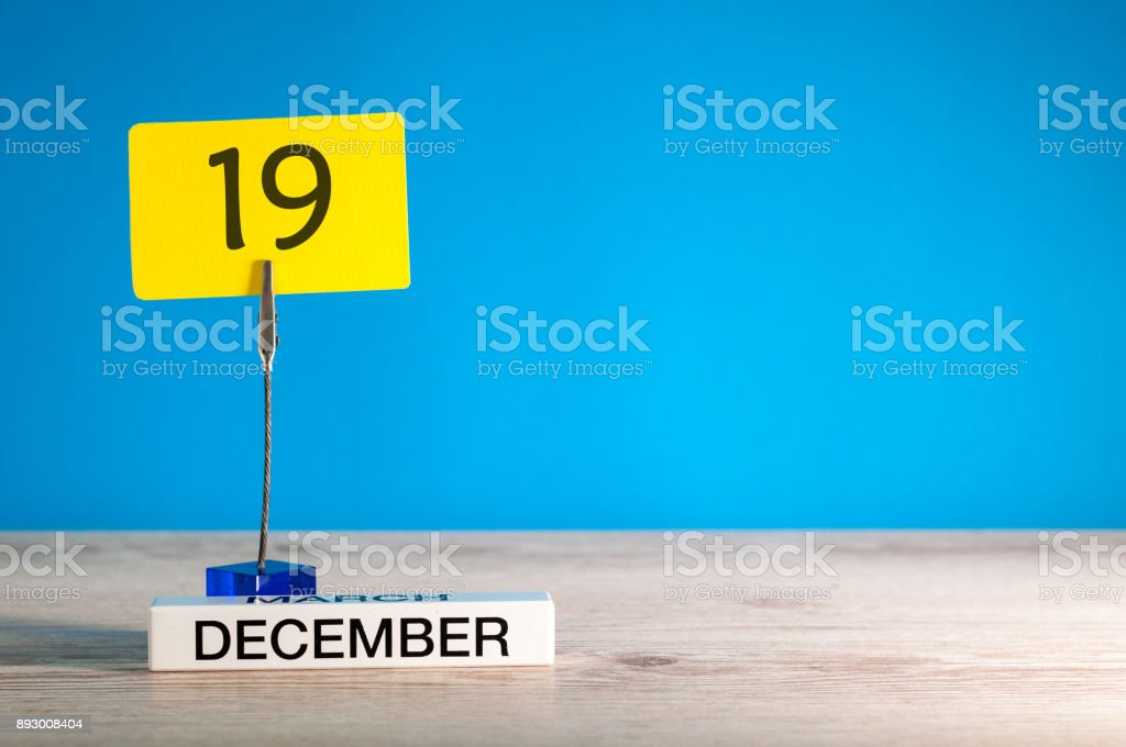 December 19th mockup. Day 19 of december month, calendar on blue background. Winter time. Empty space for text stock photo