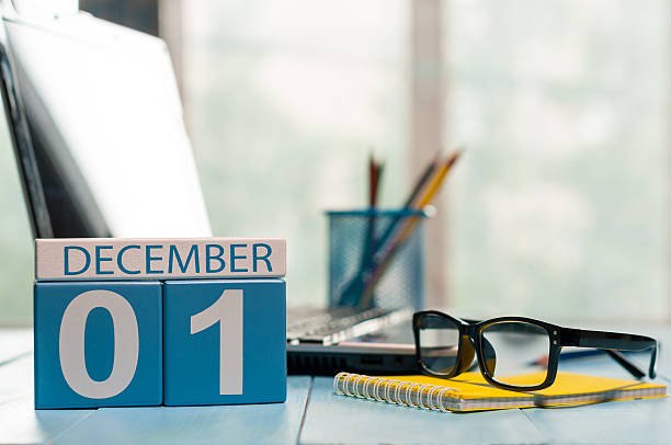December 1st. Day 1 of month, calendar on teacher workplace December 1st. Day 1 of month, calendar on teacher workplace background. Winter time. Empty space for text. december stock pictures, royalty-free photos & images