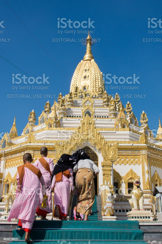 15 December 2016 Female myanmar and nun walking at Swe Taw Myat, Buddha Tooth Relic Pagoda a famous and beautiful buddhist temple in yangon , myanmar stock photo
