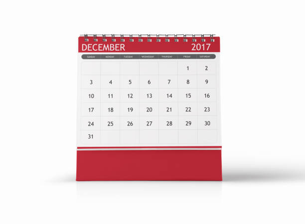 december 2017 desktop calendar on white background - december stock photos and pictures