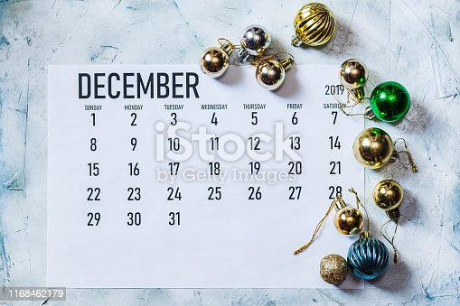 December 2019 monthly Calendar with Christmas decoration. Festive decor elements
