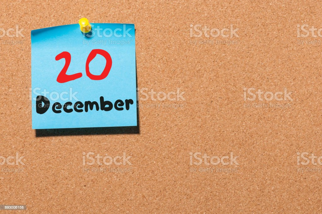 December 20th. Day 20 of month, Calendar on cork notice board. Winter time. Empty space for text stock photo