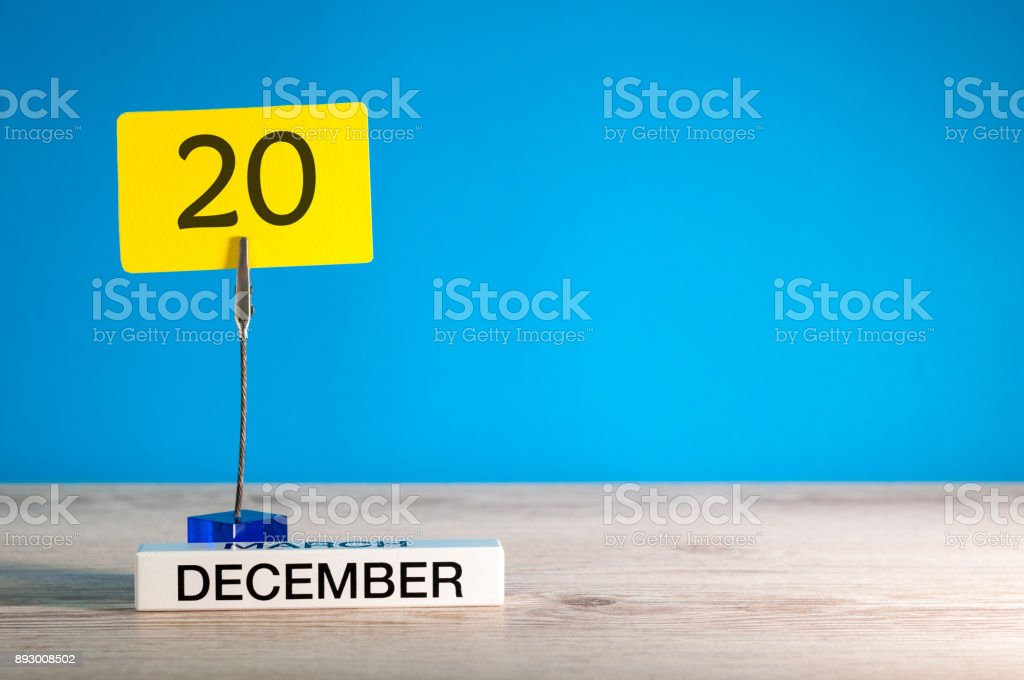 December 20th mockup. Day 20 of december month, calendar on blue background. Winter time. Empty space for text stock photo