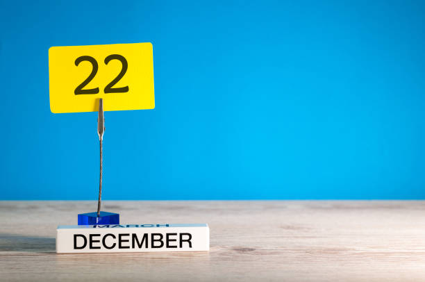 December 22nd mockup. Day 22 of december month, calendar on blue background. Winter time. Empty space for text stock photo