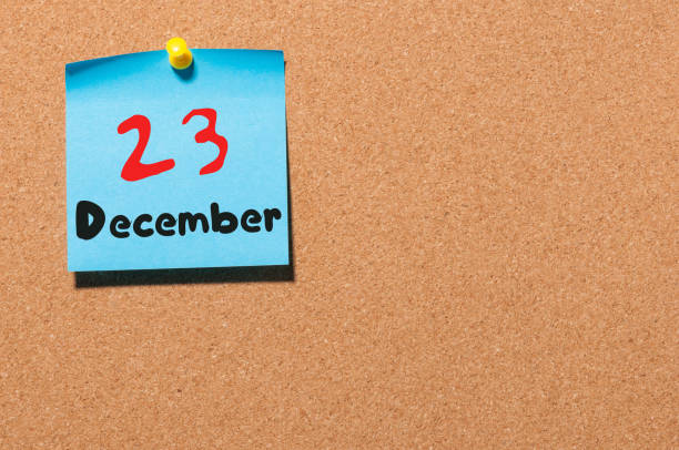 december 23rd. day 23 of month, calendar on cork notice board. winter time. empty space for text - number 23 stock photos and pictures
