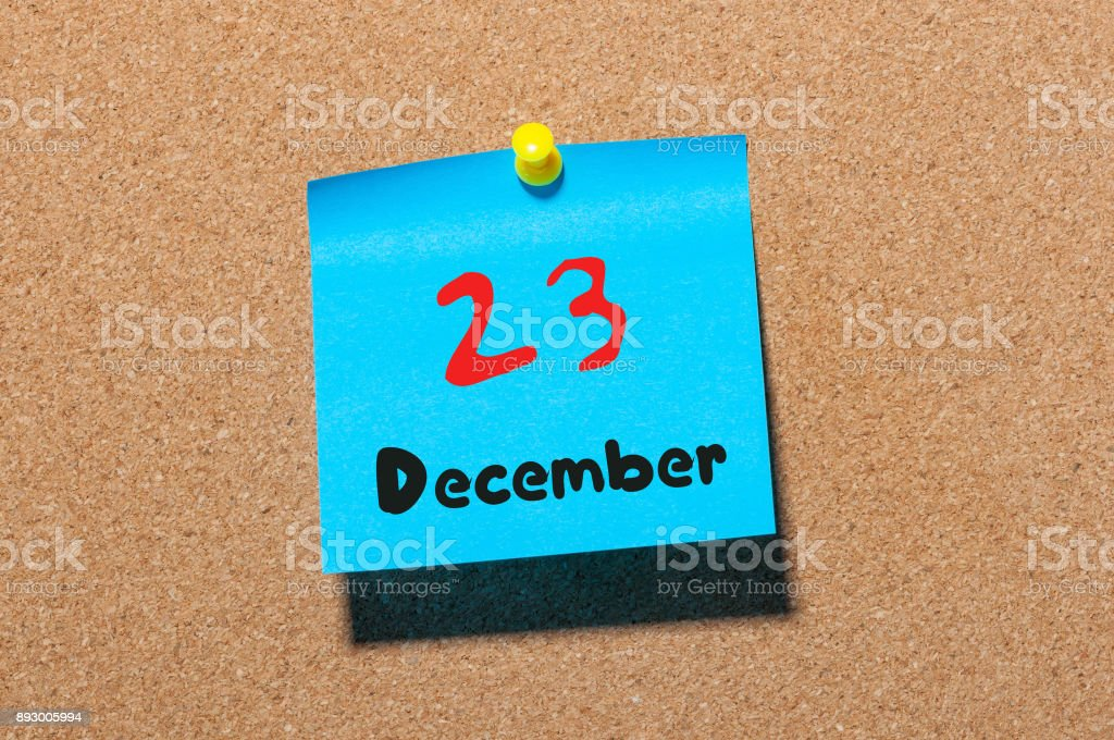 December 23rd. Day 23 of month, Calendar on cork notice board. Winter time. Empty space for text stock photo