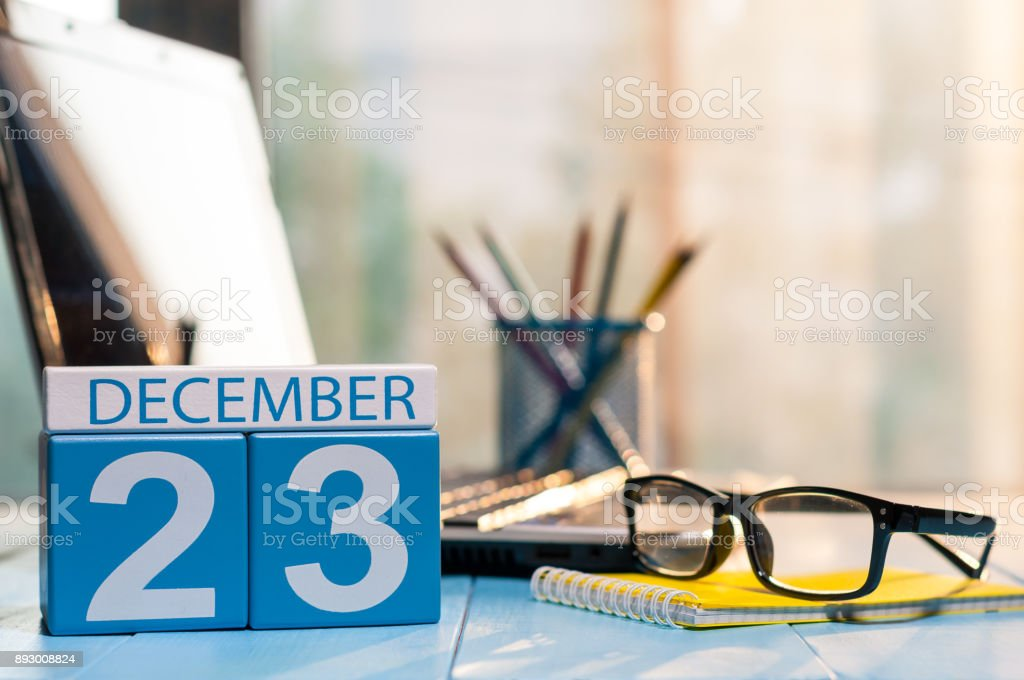 December 23rd. Day 23 of month, calendar on student workplace background. Winter time. Empty space for text stock photo