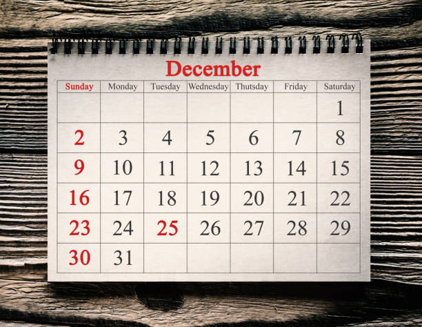 December 25 in the calendar on the wood background December 25 in the calendar on the wood background december stock pictures, royalty-free photos & images