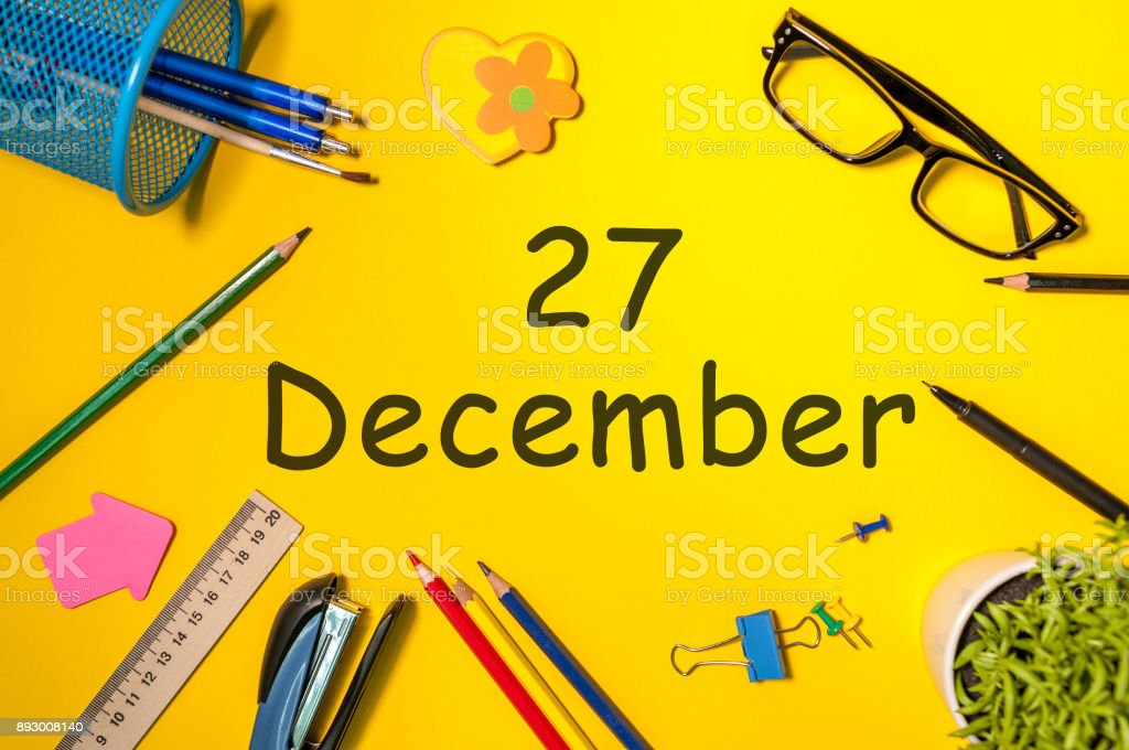 December 27th. Day 27 of december month. Calendar on yellow businessman workplace background. Winter time stock photo