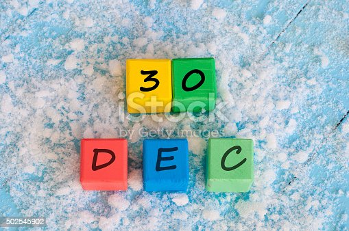 968874704istockphoto December 30 calendar on color wooden toy cubes 502545902