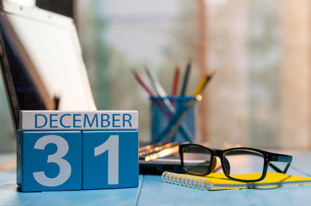 December 31st. Day 31 of month, calendar on workplace background. New year at work concept. Winter time. Empty space for text stock photo