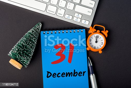 istock December 31st. Image 31 day of december month, calendar on workplace background. New year at work concept 1193134712