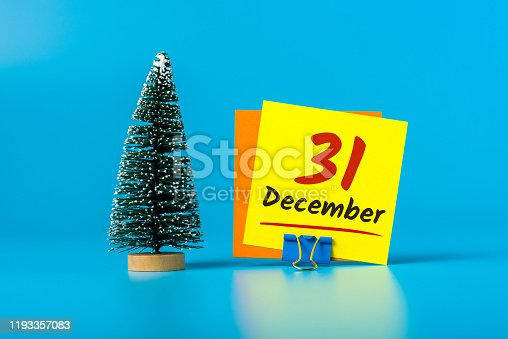 istock December 31st. Image 31 day of december month, calendar with Christmas tree on blue background. New year 2020 1193357083