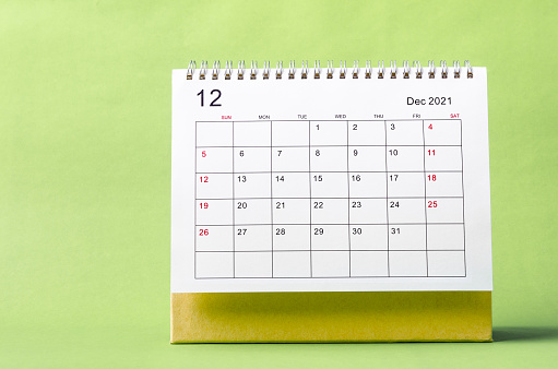 December Calendar 2021 on green background.