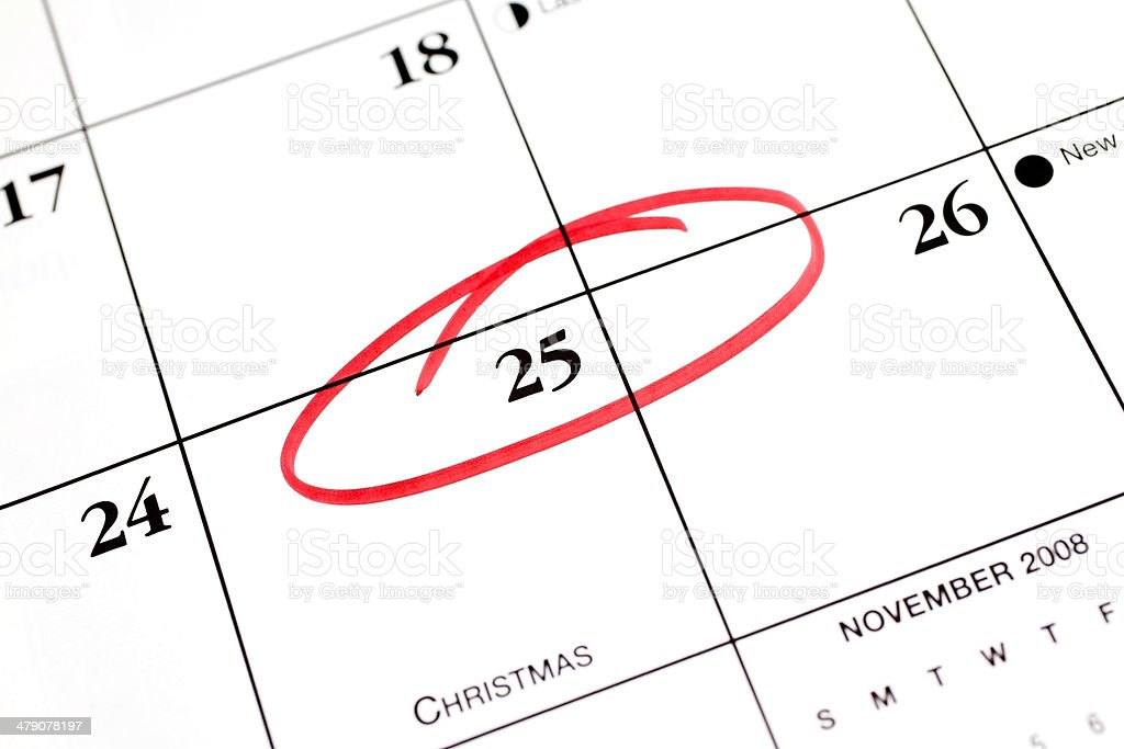 December calendar with the 25th circled.  Christmas day. Red. royalty-free stock photo