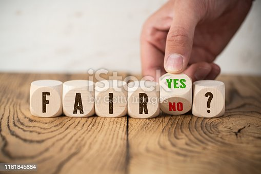 922107104istockphoto deciding between fair and unfair 1161845684