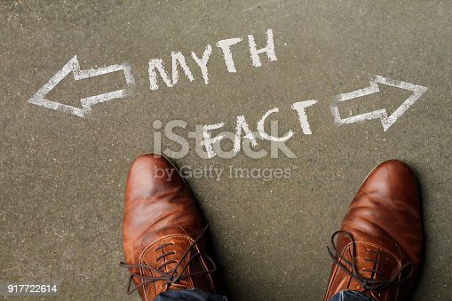 Man in brown shoes having to decide between myth and fact