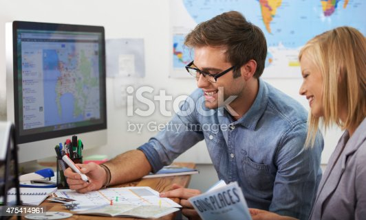 An attractive man and woman planning vacation overseas