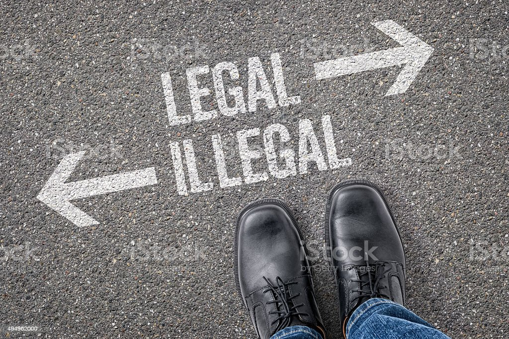 Decision at a crossroad - Legal or Illegal stock photo