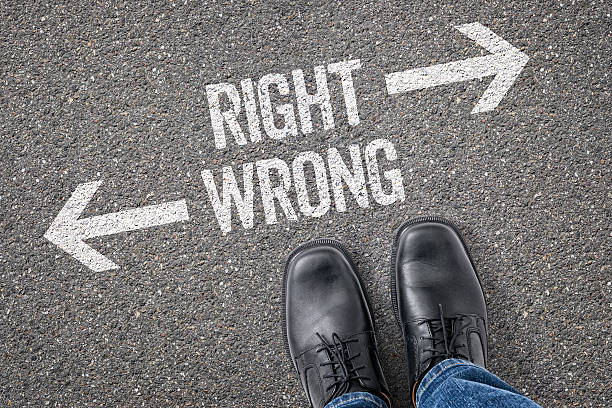 Decision at a crossroad - Right or Wrong stock photo
