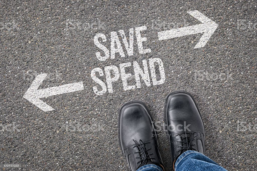 Decision at a crossroad - Save or Spend stock photo