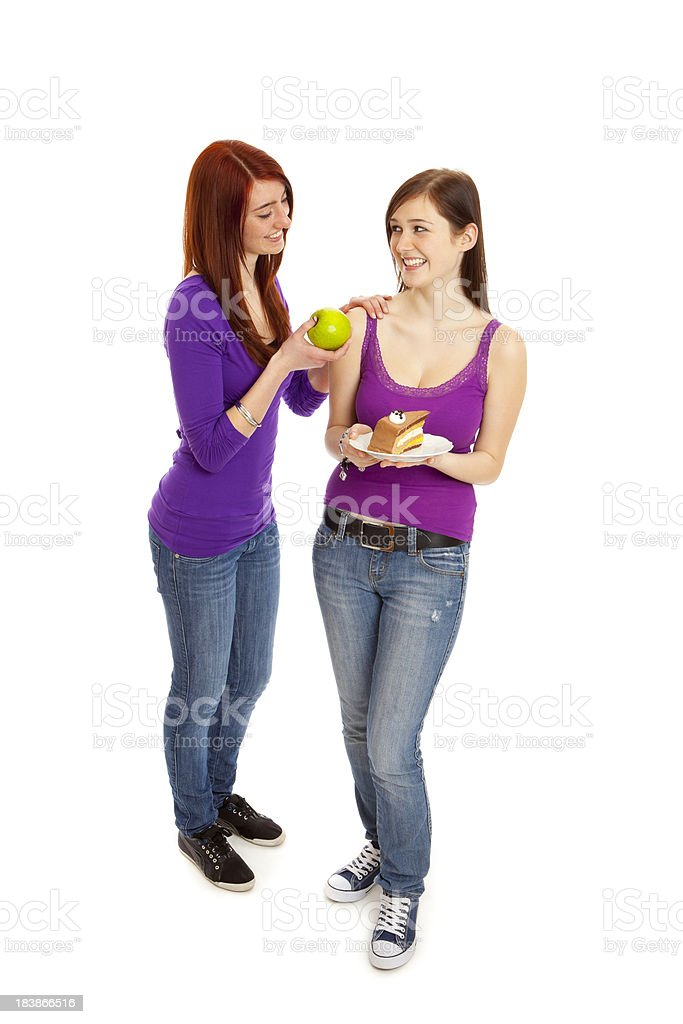 Decision between apple and cake royalty-free stock photo