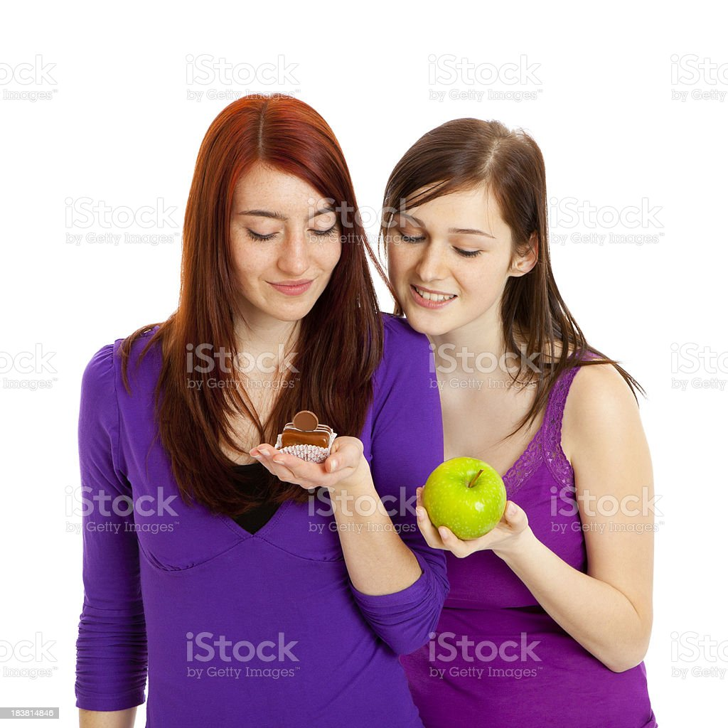 Decision between cake and apple royalty-free stock photo