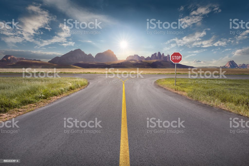 Decision for the right and a wrong way at intersection stock photo
