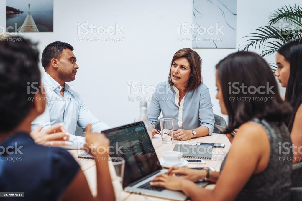 Decision makers and policy makers discussing new regulations in Australia stock photo