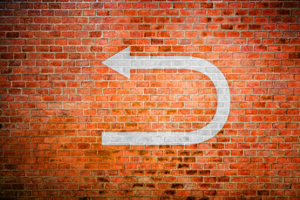 Decision making White turnaround sign on vintage brick wall bending over backwards stock pictures, royalty-free photos & images