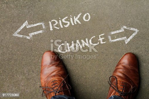 istock Decision time: Risk or Opportunity (in German: Risiko / Chance) 917723060