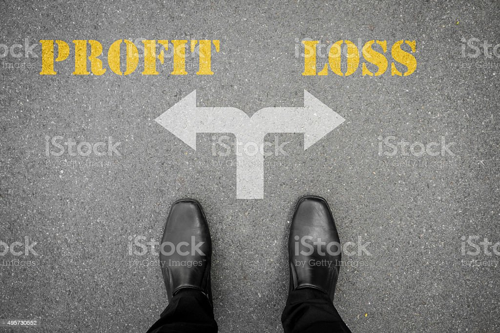 Decision to make at the cross road, profit or loss stock photo