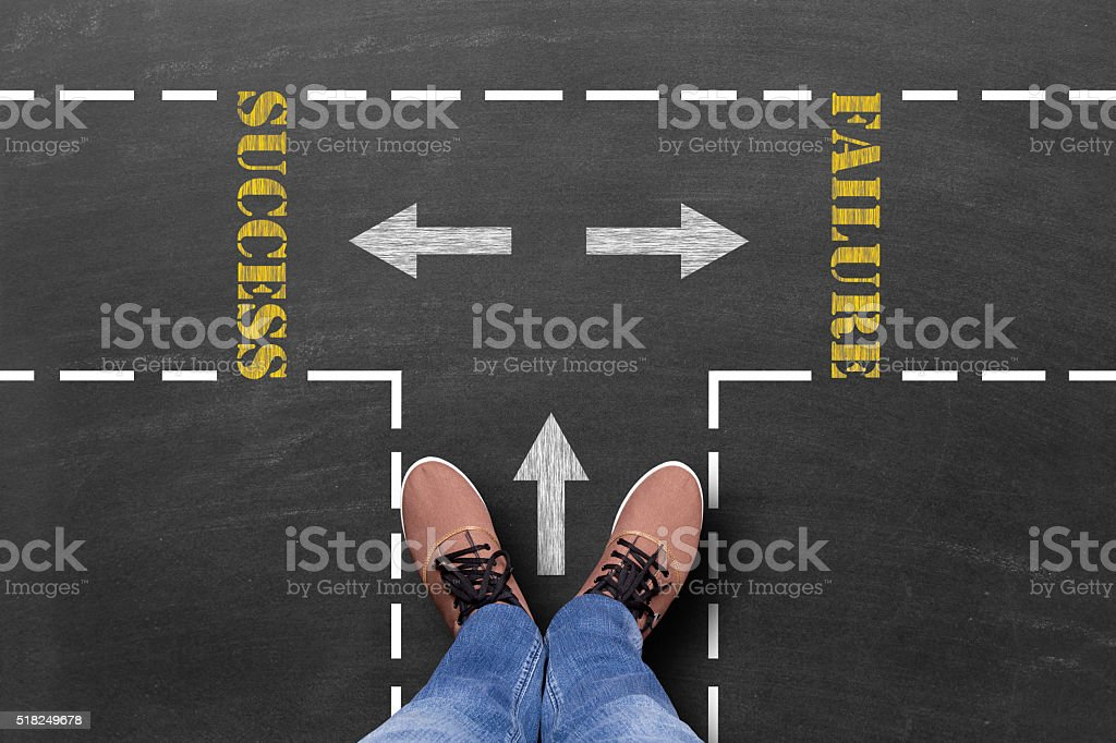 Decision to make at the crossroad, success or failure stock photo