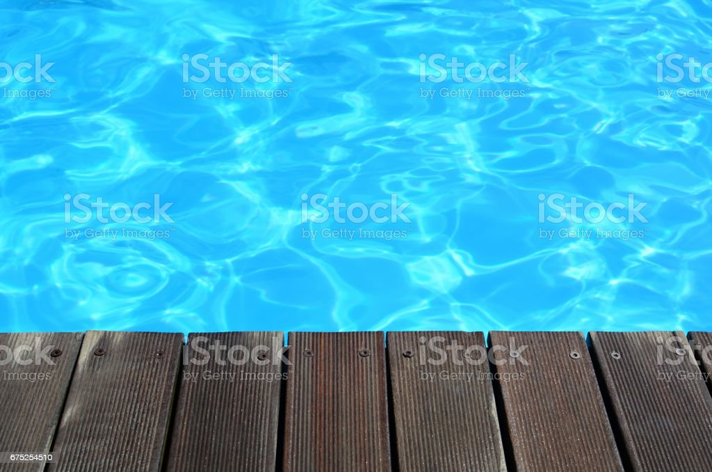 Deck and clear turquoise water background stock photo