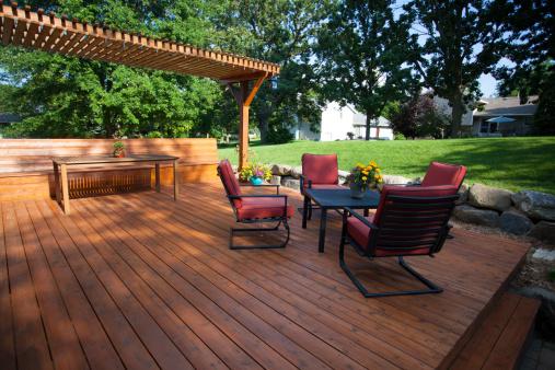 Backyard deck and pergola landscaping.