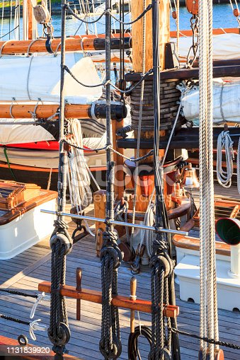 Old vessel sail ship - deck and ropes, rigging on a wooden sailboat - detail close up
