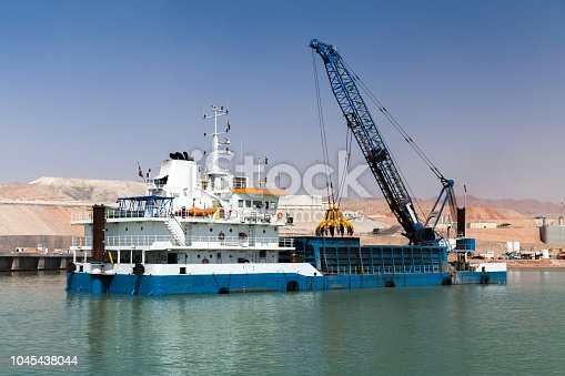 Deck cargo ship, dredging works in new Aqaba port, Jordan